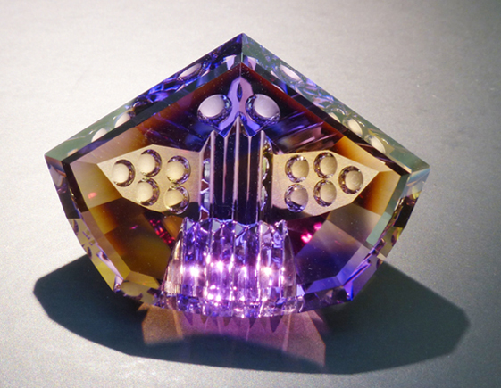 fancy carved faceted ametrine with optical dishes