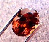 garnet_cc_218pt_oval_smky-orang_red-orange