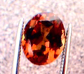 garnet_cc_220pt_oval_smky-orang_red-orange