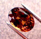 garnet_cc_273pt_oval_smky-orang_red-orange