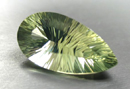 concave faceted green quartz