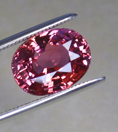 large orange-pink unheated gia certed 3.55ct pad sapphire