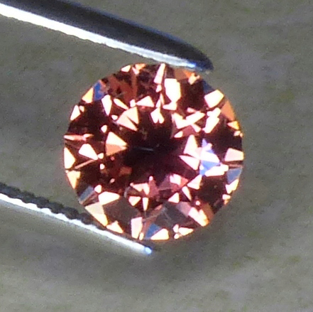 certed 68pt round orange to pink sapphire