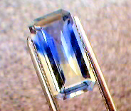 yellow sapphire with blue arrow