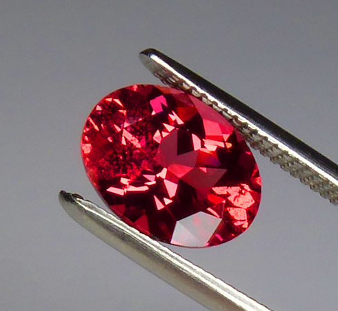 1.32ct mahenge spinel of a neon reddish-orange-pink color