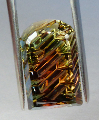 oregon watermelon sunstone with schiller - concave faceted