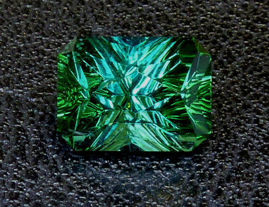 nuristani blue green concave cut tourmaline