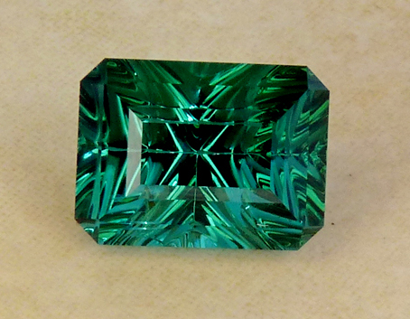 greenish-blue to blue concave faceted tourmaline