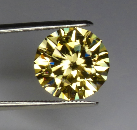 round yellow zircon with dispersion