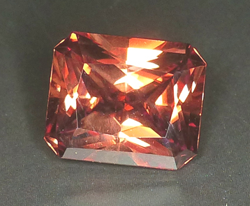 8+ct emerald cut orangy zircon