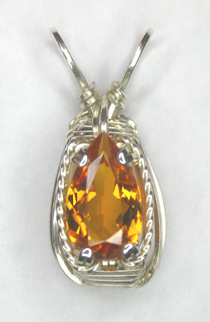 All That Glitters orange tourmaline wire wrap