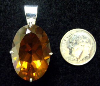 topaz colored quartz set in sterling pendant