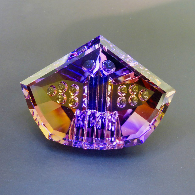70+ct fancy ametrine with optical dishes